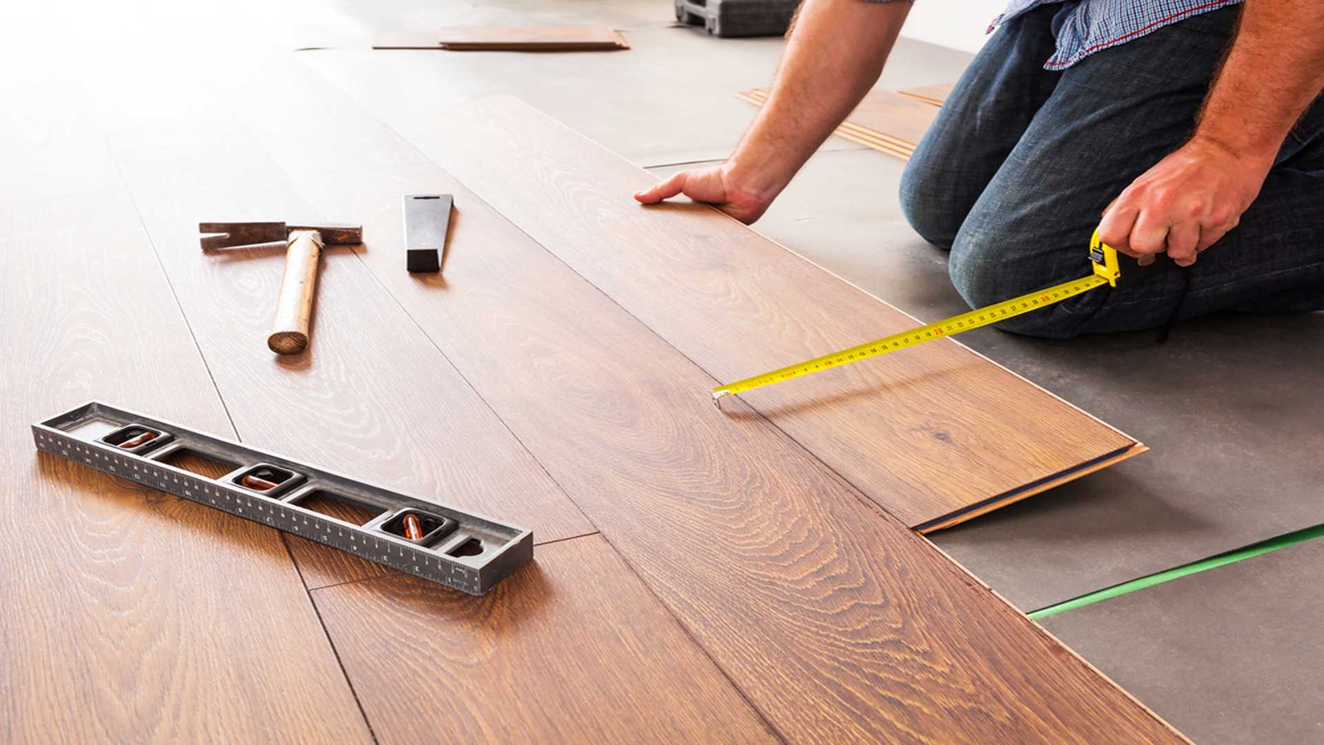 Man Installing Hardwood Floors Hardwood Flooring Installation Gutter Solutions and Home Improvements Pensacola FL 850 776 1782