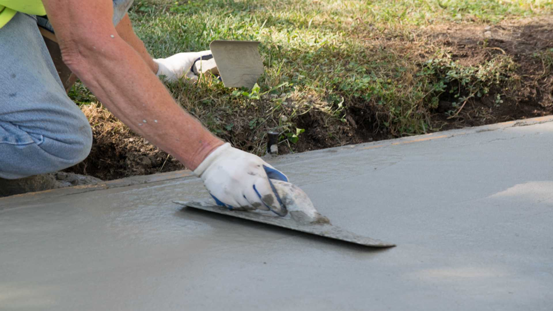 Man Pouring Concrete Driveway Concrete Services Gutter Solutions and Home Improvements Pensacola FL 850 776 1782