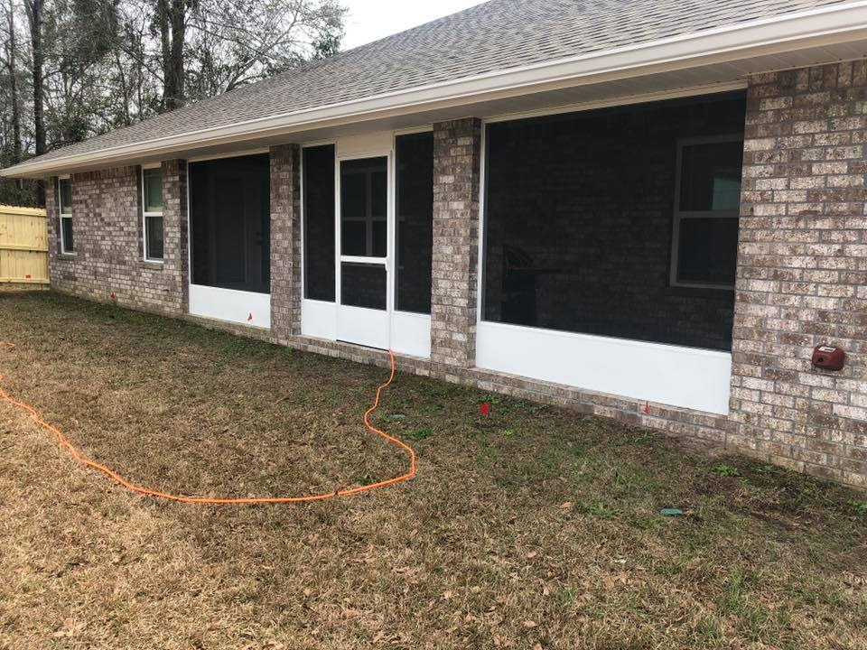 House With Screened Porch Screen Porch Repair And Installation Gutter Solutions And Home Improvements Navarre FL 850 776 1782 https seamlessgutterspensacola.com