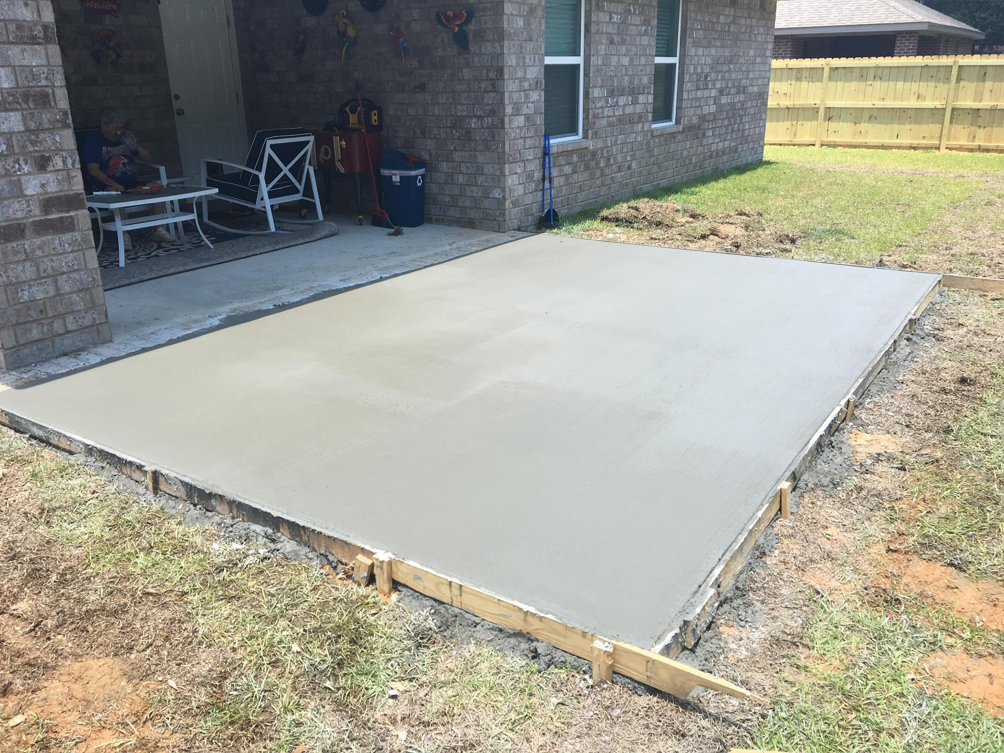 Installing A Cement Patio Cement Installation Gutter Solutions And Home Improvements Navarre FL 850 776 1782 https seamlessgutterspensacola.com 1